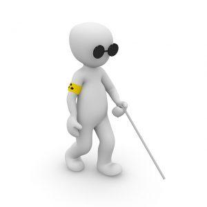 Auf diesem Bild sieht man an der Person die mit einem langen Stock dem Weg entlang geht. Die Person ist in hellgrau dargestellt genauso wie der Langstock. Am Oberarm trägt er eine blindenbinde, die man an der gelben Farbe mit den schwarzen Punkten erkennen kann.
